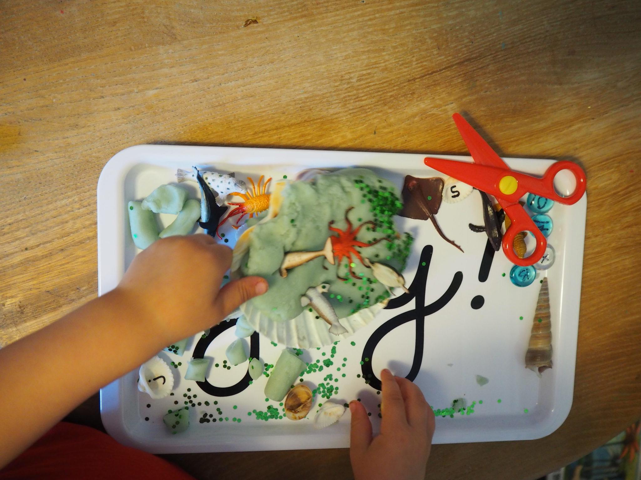 child playing handmade playdough