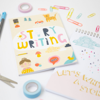 little writing company book flat lay with tape pens scissors