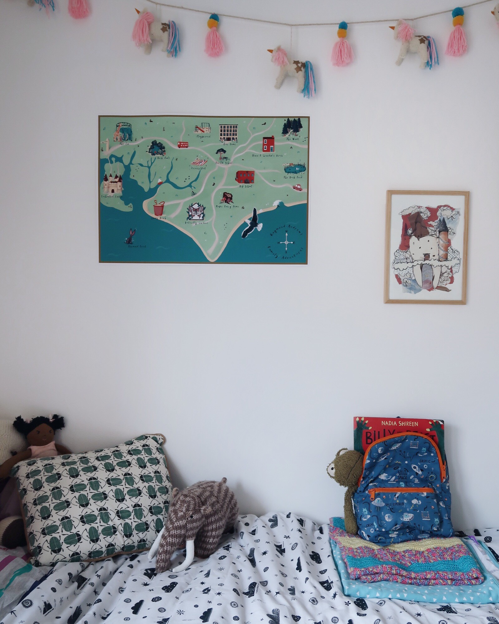 Ink and Tot bespoke map on a white wall above a bed