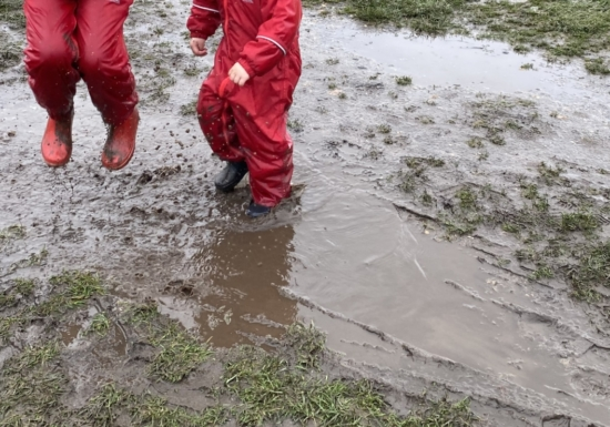 kids jumping in puddles