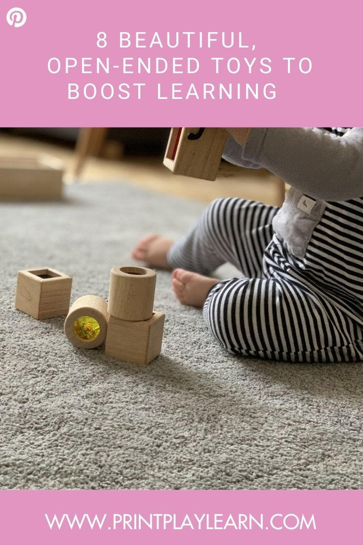 pink border print play learn white writing kid playing with wood blocks 8 beautiful open ended toys